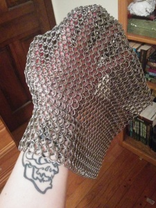 Chain mail. Effective protection against swords, not so good against arrows, poignards and smaller daggers.